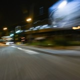 Motion blurred urban city road at night streetlit backplate