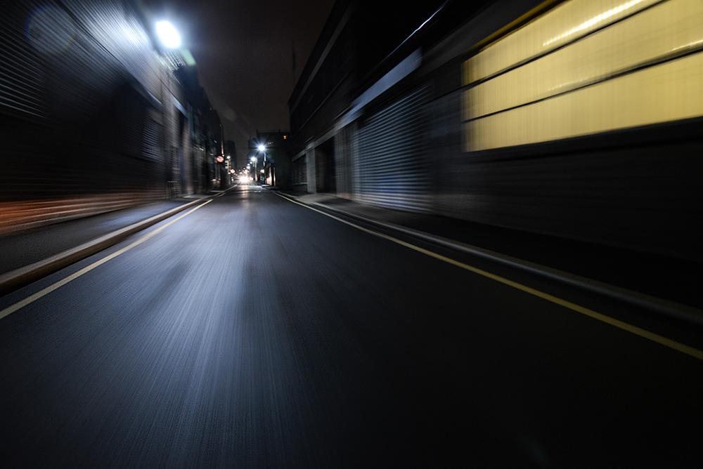 Motion blurred urban city road at night streetlit backplate
